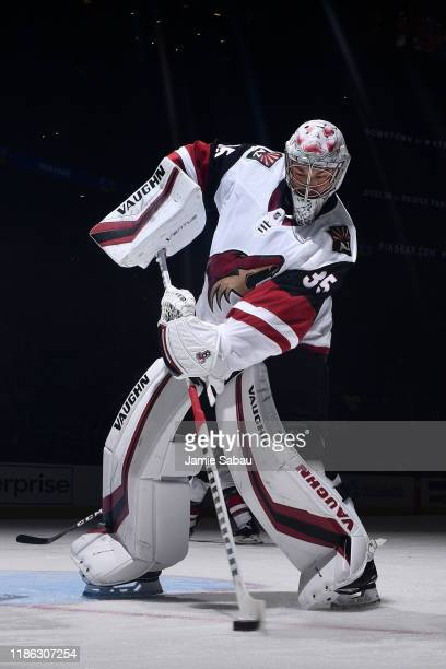 Goaltender Darcy Kuemper of the Arizona Coyotes plays the puck during the first period of a game against the Columbus Blue Jackets on December 3 2019...