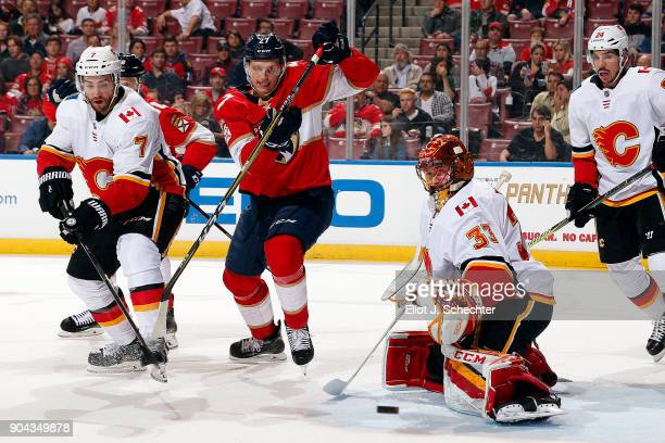 Goaltender David Rittich of the Calgary Flames defends the net during the first period against Nick Bjugstad of the Florida Panthers at the BBT...