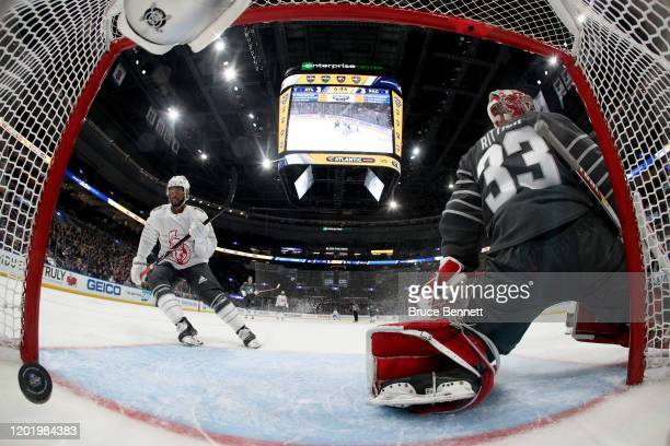 Goaltender David Rittich of the Calgary Flames gives up a goal to Anthony Duclair of the Ottawa Senators in the game between Atlantic Division v...