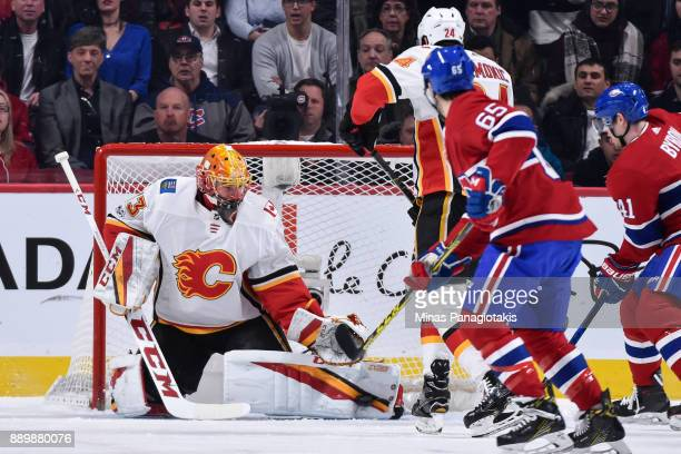 Goaltender David Rittich of the Calgary Flames makes a pad save against the Montreal Canadiens during the NHL game at the Bell Centre on December 7...