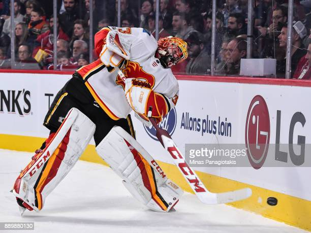 Goaltender David Rittich of the Calgary Flames plays the puck around the boards against the Montreal Canadiens during the NHL game at the Bell Centre...