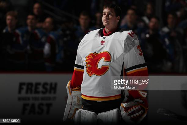 Goaltender David Rittich of the Calgary Flames stands during the anthem prior to the game against the Colorado Avalanche at the Pepsi Center on...