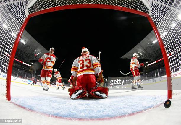 Goaltender David Rittich, T.J. Brodie and Travis Hamonic of the Calgary Flames react after Bryan Little of the Winnipeg Jets scored the game-winning...