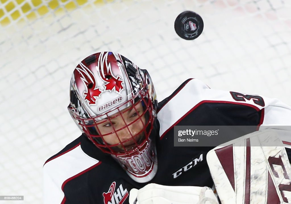 Goaltender David Tendeck #30 of the Vancouver Giants makes a save against the Tri-City Americans during the first period of their WHL game at the Langley Events Centre on October 6, 2017 in Langley, British Columbia, Canada.