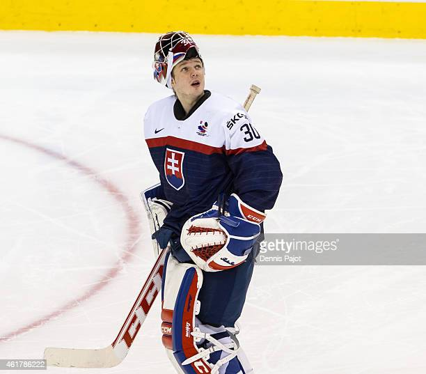 Goaltender Denis Godla of Slovakia has a look at the scoreboard between shifts during the Bronze medal game against Sweden in the 2015 IIHF World...