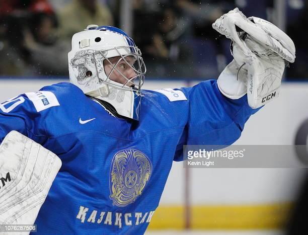 Goaltender Denis Karatayev of Kazakhstan makes a glove save versus Sweden at the IIHF World Junior Championships at the Save-on-Foods Memorial Centre...