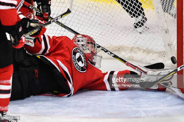 Goaltender Dereck Baribeau of the Quebec Remparts allows a goal early in the first period against the BlainvilleBoisbriand Armada during the QMJHL...