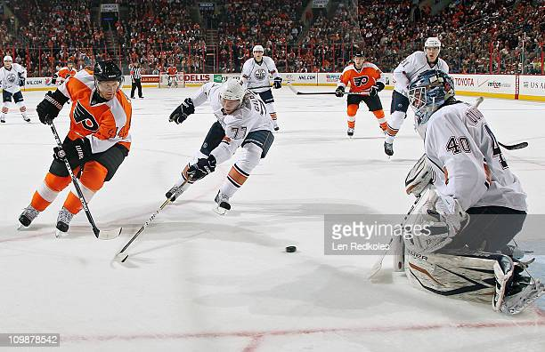 Goaltender Devan Dubnyk and Tom Gilbert of the Edmonton Oilers defend the loose puck from Kimmo Timonen of the Philadelphia Flyers on March 8 2011 at...