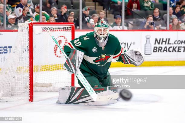 Goaltender Devan Dubnyk of the Minnesota Wild keeps an eye on the flying puck during second period action against the Winnipeg Jets at the Xcel...