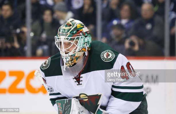 Goaltender Devan Dubnyk of the Minnesota Wild looks on during third period action against the Winnipeg Jets at the MTS Centre on February 7 2017 in...