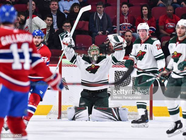 Goaltender Devan Dubnyk of the Minnesota Wild raises his arms up in victory against the Montreal Canadiens during the NHL game at the Bell Centre on...