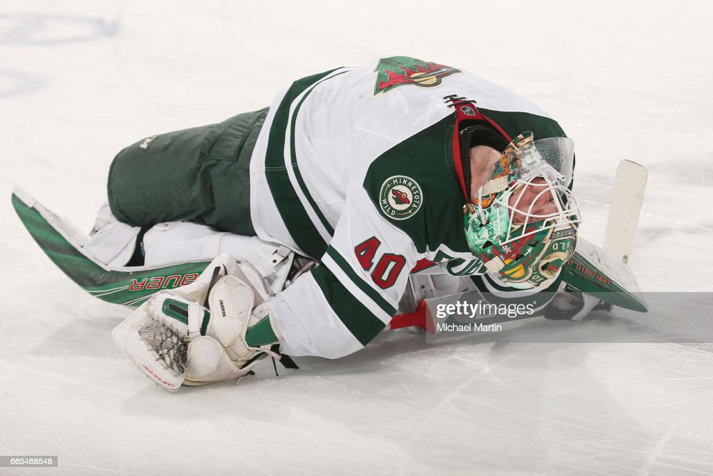 Goaltender Devan Dubnyk #40 of the Minnesota Wild stretches, prior to the game against the Colorado Avalanche at the Pepsi Center on April 6, 2017 in Denver, Colorado.