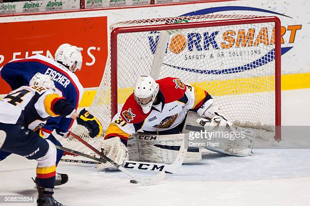 Goaltender Devin Williams of the Erie Otters makes a stick save against forward Christian Fischer of the Windsor Spitfires on February 6 2016 at the...