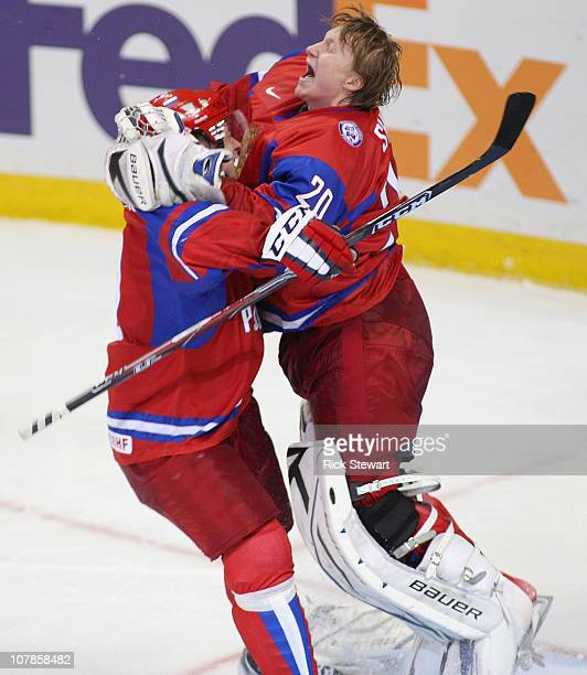 Goaltender Dmitri Shikin and Vladimir Tarasenko of Russia celebrate defeating Sweden 43 in a shootout during the 2011 IIHF World U20 Championship...