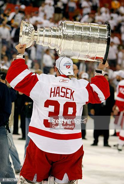 Goaltender Dominik Hasek of the Detroit Red Wings hoists the Stanley Cup after defeating the Pittsburgh Penguins 3-2 in game six of the 2008 NHL...