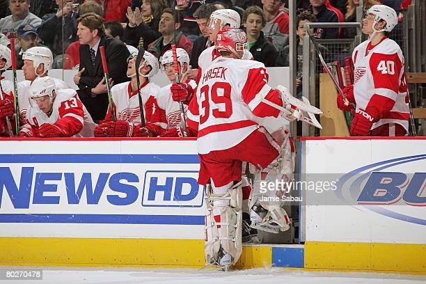Goaltender Dominik Hasek of the Detroit Red Wings is pulled from the game against the Columbus Blue Jackets after Hasek allowed four goals on 10...