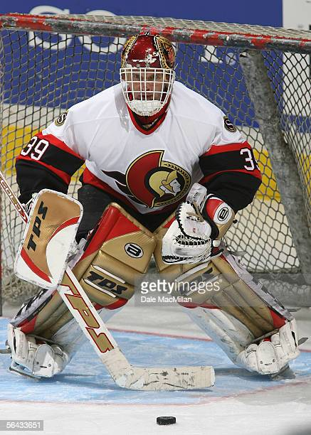 Goaltender Dominik Hasek of the Ottawa Senators warms up during an intermission to the NHL game against the Calgary Flames at Pengrowth Saddledome on...