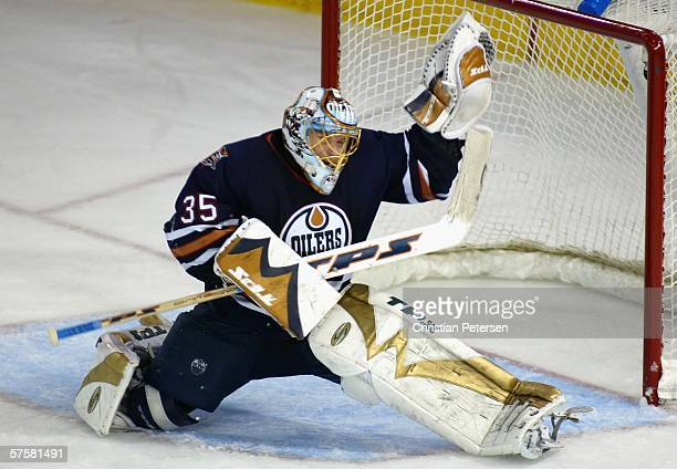 Goaltender Dwayne Roloson of the Edmonton Oilers makes a glove save on the shot from Jonathan Cheechoo of the San Jose Sharks in the second overtime...