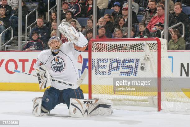 Goaltender Dwayne Roloson of the Edmonton Oilers makes a save against the Columbus Blue Jackets on December 31, 2007 at Nationwide Arena in Columbus,...