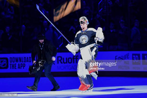 Goaltender Elvis Merzlikins of the Columbus Blue Jackets celebrates for the crowd as he is named the First Star of the Game after shutting out the...