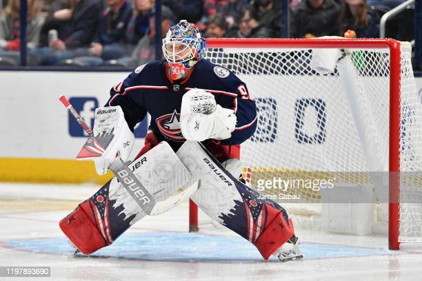 Goaltender Elvis Merzlikins of the Columbus Blue Jackets defends the net against the San Jose Sharks on January 4 2020 at Nationwide Arena in...