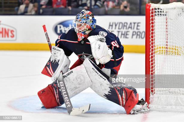 Goaltender Elvis Merzlikins of the Columbus Blue Jackets defends the net against the Carolina Hurricanes on January 16 2020 at Nationwide Arena in...