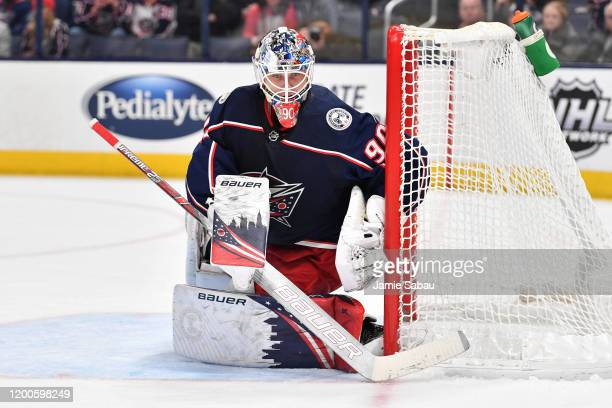 Goaltender Elvis Merzlikins of the Columbus Blue Jackets defends the net against the New Jersey Devils on January 18 2020 at Nationwide Arena in...