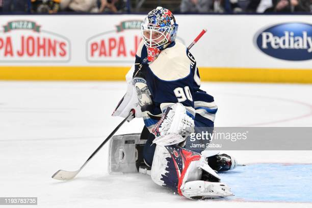 Goaltender Elvis Merzlikins of the Columbus Blue Jackets stops a shot on goal from the Boston Bruins in the second period using his chest on January...