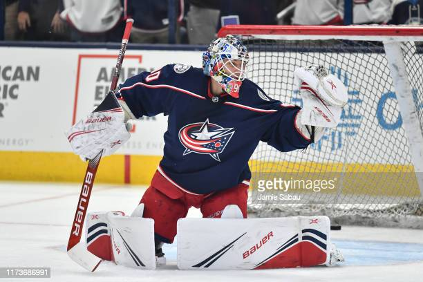 Goaltender Elvis Merzlikins of the Columbus Blue Jackets warms up prior to the season opener against the Toronto Maple Leafs on October 4 2019 at...