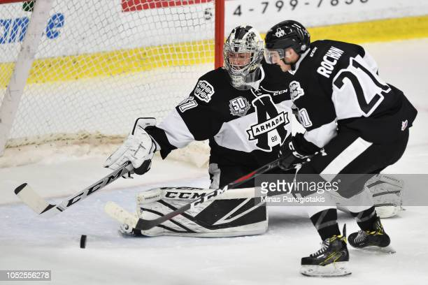 Goaltender Emile Samson of the BlainvilleBoisbriand Armada makes a stick save near teammate Antoine Rochon against the ValdOr Foreurs during the...