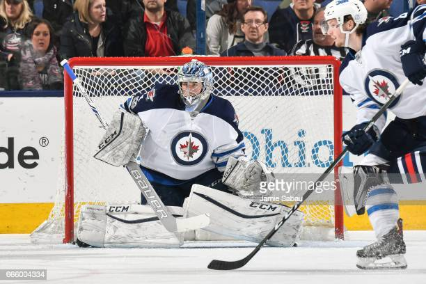Goaltender Eric Comrie of the Winnipeg Jets defends the net against the Columbus Blue Jackets on April 6 2017 at Nationwide Arena in Columbus Ohio