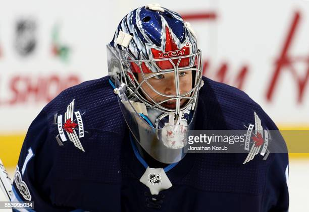Goaltender Eric Comrie of the Winnipeg Jets looks on during the pregame warm up prior to NHL action against the Vegas Golden Knights at the Bell MTS...