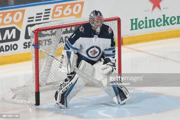 Goaltender Eric Comrie of the Winnipeg Jets warms up prior to the game against the Florida Panthers at the BBT Center on December 7 2017 in Sunrise...