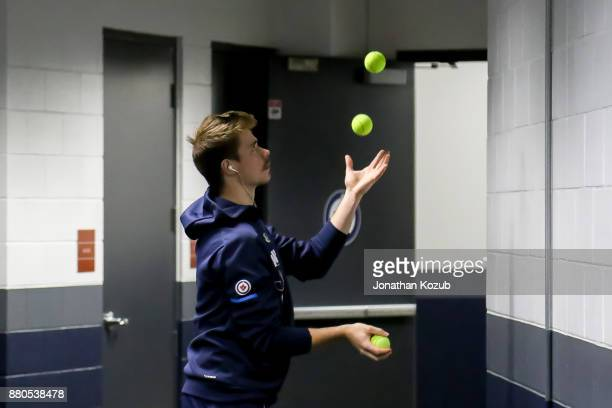 Goaltender Eric Comrie of the Winnipeg Jets warms up with some juggling prior to NHL action against the Minnesota Wild at the Bell MTS Place on...