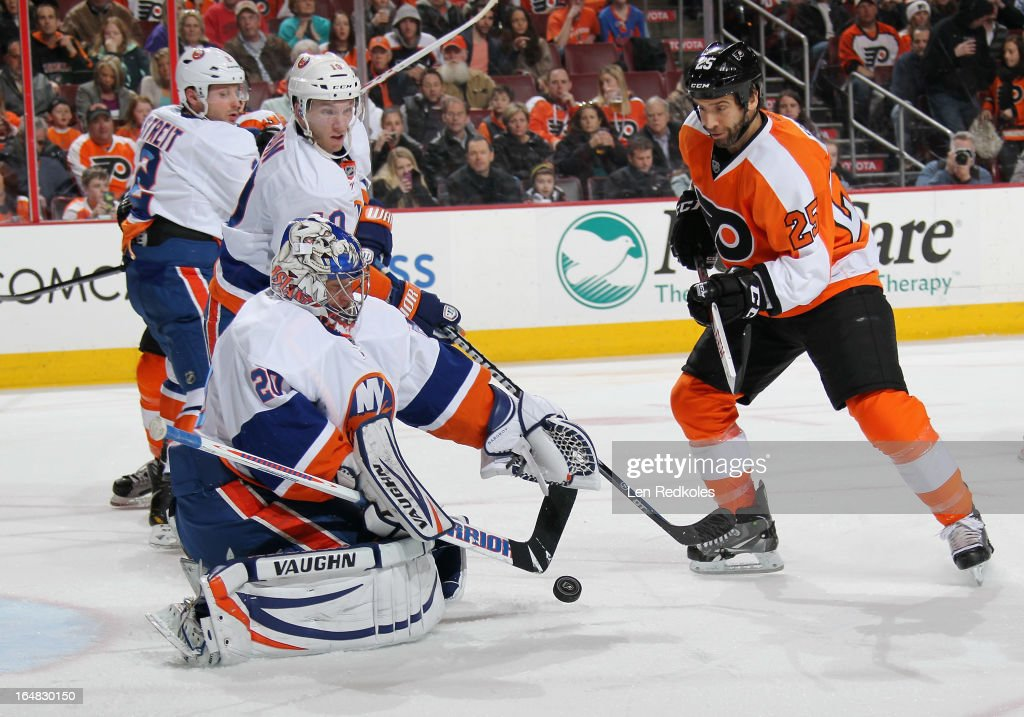 Goaltender Evgeni Nabokov #20 and Keith Aucoin #10 of the New York Islanders defend against Maxime Talbot #25 of the Philadelphia Flyers on March 28, 2013 at the Wells Fargo Center in Philadelphia, Pennsylvania.