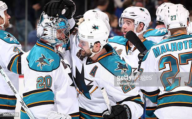 Goaltender Evgeni Nabokov is congratulated by teammate Dan Boyle of the San Jose Sharks following a game against the Colorado Avalanche in game Six...