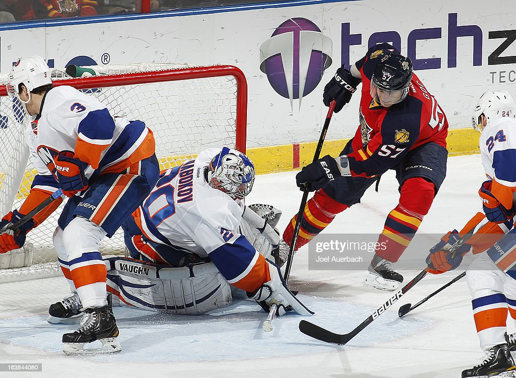 Goaltender Evgeni Nabokov #20 of the New York Islanders stops a shot by Marcel Goc #57 of the Florida Panthers during third period action at the BB&T Center on March 16, 2013 in Sunrise, Florida. The Islanders defeated the Panthers 4-3.