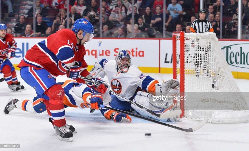 Goaltender Evgeni Nabokov #20 of the New York Islanders stretches to block a shot from Tomas Plekanec #14 of the Montreal Canadiens during the NHL game on February 21, 2013 at the Bell Centre in Montreal, Quebec, Canada.