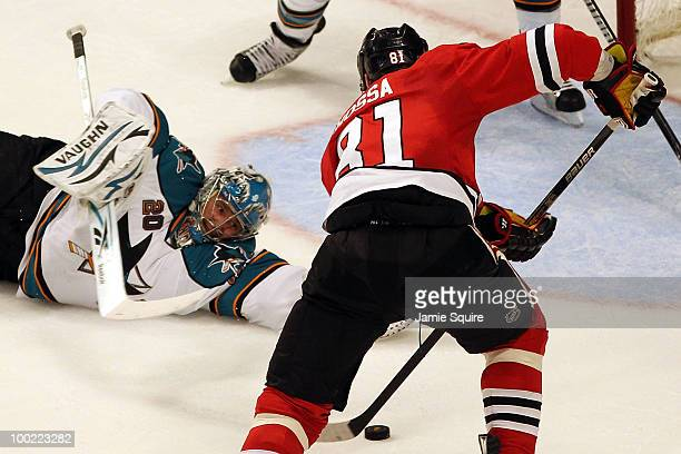Goaltender Evgeni Nabokov of the San Jose Sharks dives to make a save against Marian Hossa of the Chicago Blackhawks in the second period of Game...