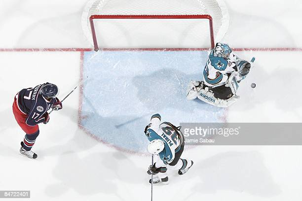 Goaltender Evgeni Nabokov of the San Jose Sharks makes a save against the Columbus Blue Jackets on February 7 2009 at Nationwide Arena in Columbus...