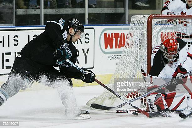 Goaltender Frank Doyle of the Lowell Devils makes the stop on Josh Prudden of the Worcester Sharks in American Hockey League action on January 19...