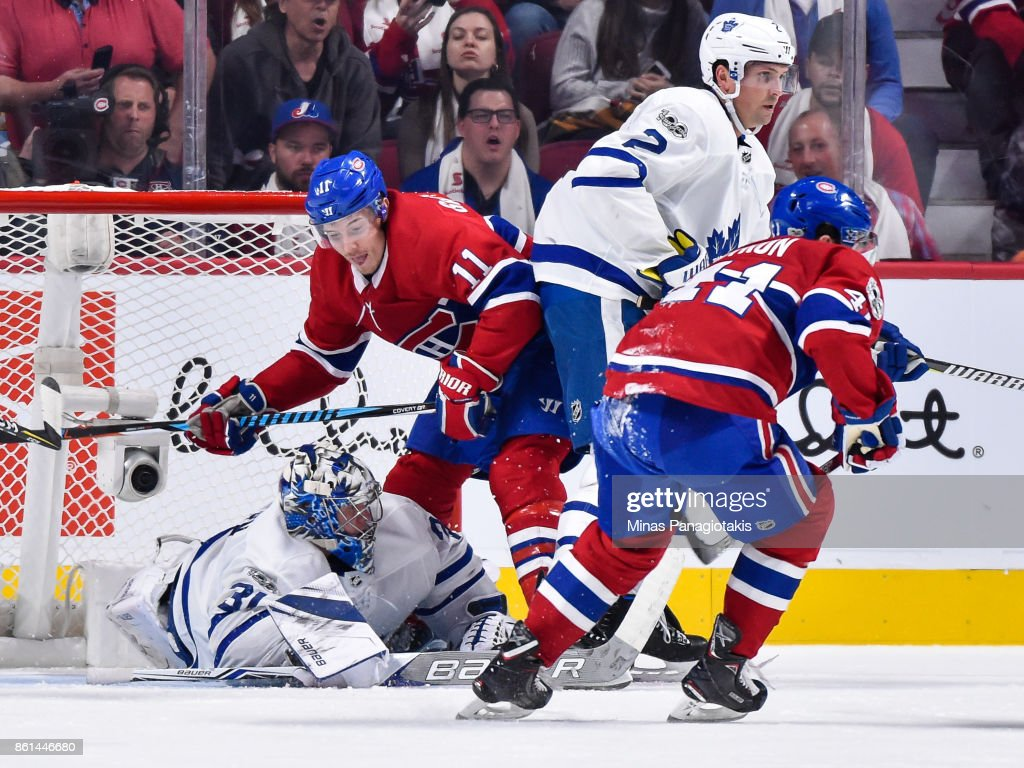 Goaltender Frederik Andersen #31 of the Toronto Maple Leafs dives in front of Brendan Gallagher #11 of the Montreal Canadiens to make a save during the NHL game at the Bell Centre on October 14, 2017 in Montreal, Quebec, Canada. The Toronto Maple Leafs defeated the Montreal Canadiens 4-3 in overtime.