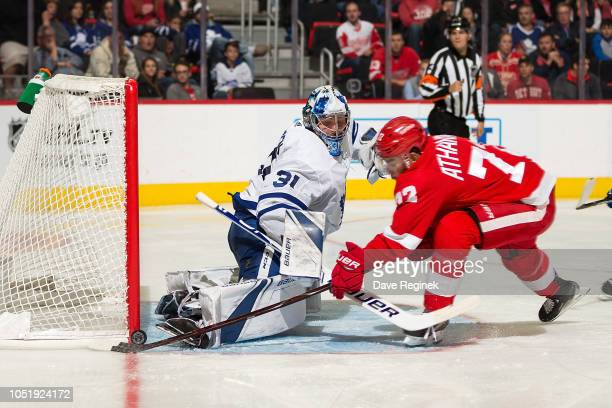 Goaltender Frederik Andersen of the Toronto Maple Leafs makes a skate save as Andreas Athanasiou of the Detroit Red Wings tries to score a goal...
