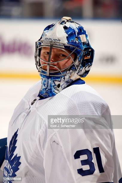 Goaltender Frederik Andersen of the Toronto Maple Leafs stretches on the ice during warm ups prior to the start of the game against the Florida...