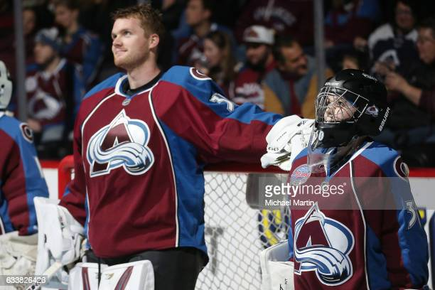 A goaltender from the Avalanche Pee Wee team stands next to goaltender Calvin Pickard of the Colorado Avalanche prior to the game against the...