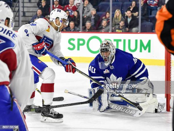 Goaltender Garret Sparks of the Toronto Marlies makes a save on Jordan Boucher of the Laval Rocket during the AHL game at Place Bell on November 1...