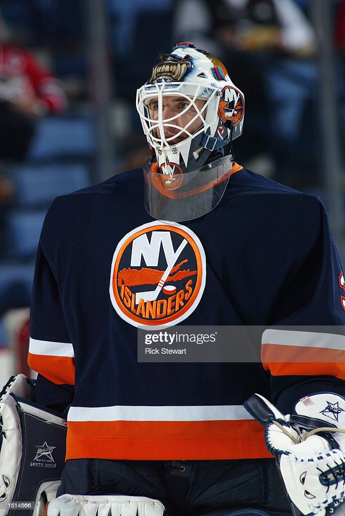 Goaltender Garth Snow #30 of the New York Islanders looks on during warm-ups prior to the start of the NHL game against the Buffalo Sabres on October 10, 2002 at HSBC Arena in Buffalo, New York. The Sabres defeated the Islanders 5-1.