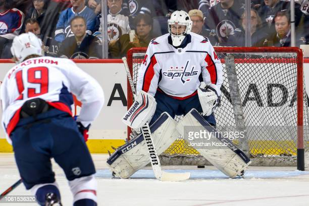 Goaltender Gavin McHale of the Washington Capitals faces shots from Nicklas Backstrom during the pregame warm up prior to NHL action against the...