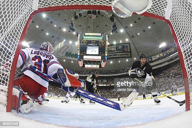 Goaltender Henrik Lundqvist moves across the crease to stop Ryan Malone of the Pittsburgh Penguins during game two of the Eastern Conference...