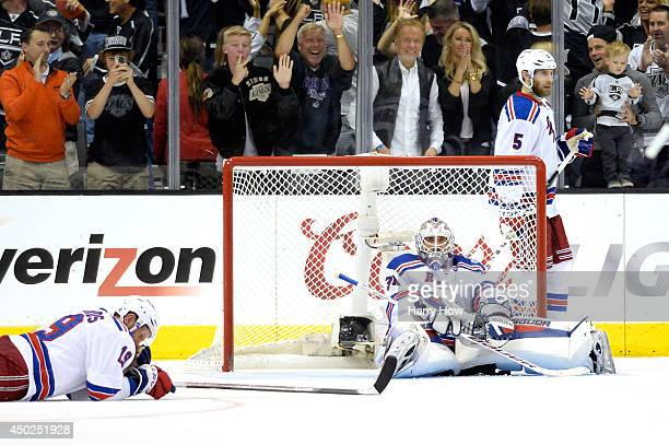 Goaltender Henrik Lundqvist of the New York Rangers and Brad Richards sit on the ice after allowing the game winning goal in double overtime to...